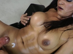 Smoking hot busty shemale Lorraine Balde shows off her hard big sized cock before she sticks dildo in her transsexual ass. She busts a nut after playing with herself