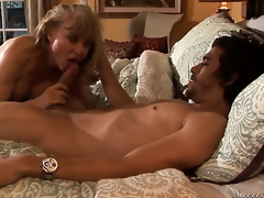 Pretty sweetie Nina Hartley finds herself sucking Xander Corvuss erect sausage