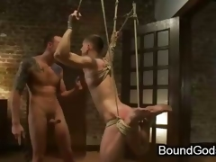 Tied up and suspended gay shocked