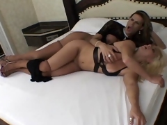 Sexy blondie gobbling on shemaleТs hard cock before bending over in the bed